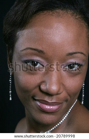 Pretty black woman looking at the camera - stock photo