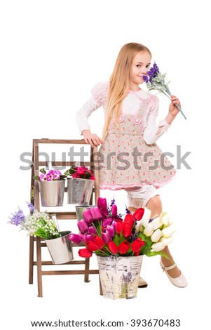 Pretty blond girl posing with flowers. Isolated on white - stock photo