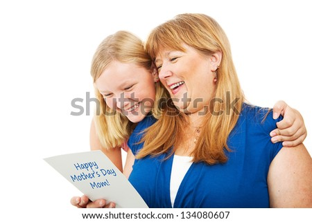 Pretty blond teenage girl gives a Mother's Day card to her mother.  Isolated on white. - stock photo