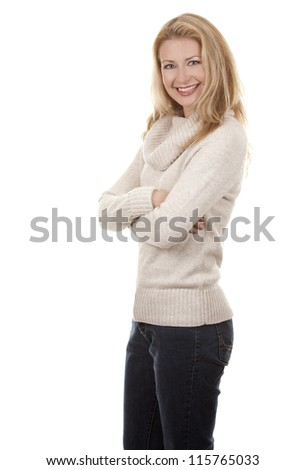 pretty blond woman wearing beige sweather on white background - stock photo