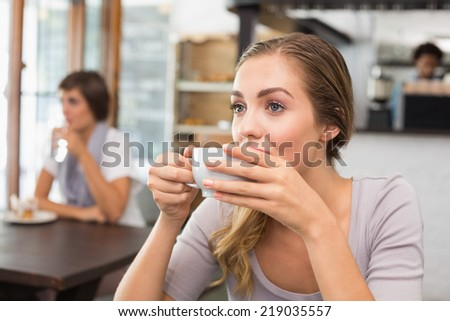Pretty blonde enjoying a coffee at the coffee shop - stock photo
