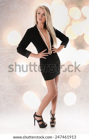 Pretty Blonde Fashion Girl with long legs - stock photo