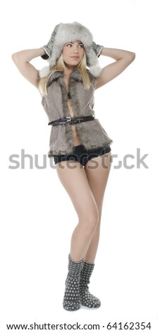 Pretty blonde girl posing in winter clothes - stock photo