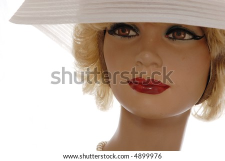pretty blonde mannequin, large white hat isolated on white - stock photo
