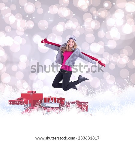 Pretty blonde posing in winter clothes against light glowing dots design pattern - stock photo