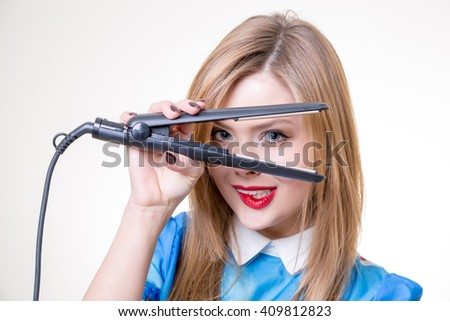 pretty blonde straight hair with iron - stock photo