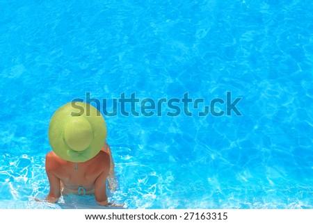 Pretty blonde woman enjoying a swimming pool in Greece - stock photo
