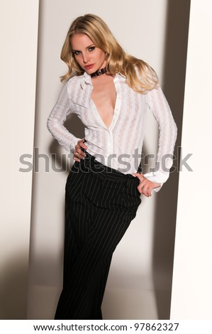 Pretty blonde woman in black and white - stock photo