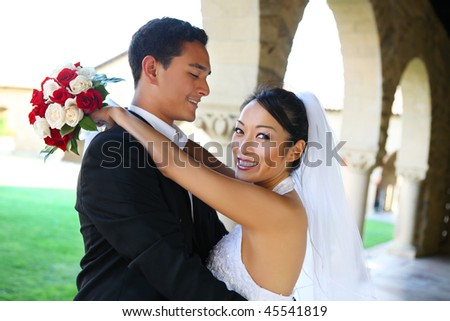 Pretty bride and handsome groom at church during wedding - stock photo
