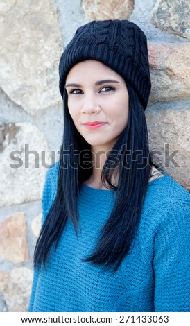 Pretty brunette girl with wool cap and piercing - stock photo