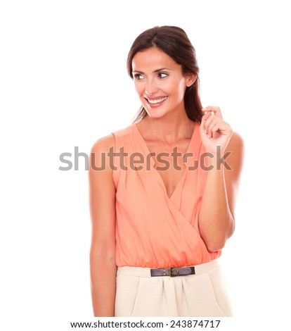 Pretty brunette lady in elegant blouse smiling and looking to her right cheerful and happy in white background - copyspace - stock photo