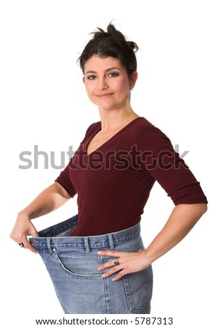 Pretty brunette proudly showing how much weight she has lost - stock photo