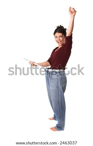 pretty brunette with a measuring tape around her waist successfully having lost weight - stock photo