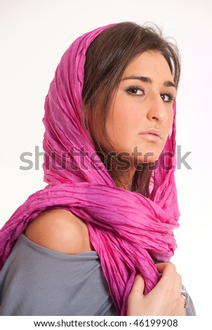 Pretty brunette with a pink silk headscarf - stock photo