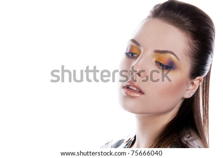 pretty brunette woman with color makeup - stock photo