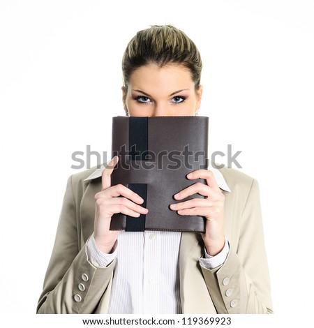 pretty buisnesswoman hiding behind a diary - stock photo