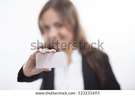 Pretty business woman handing over a card - stock photo