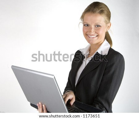 Pretty business woman on laptop computer - stock photo