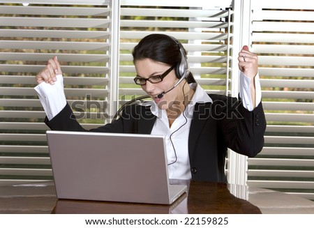 pretty business woman wearing headset and the glasses - stock photo