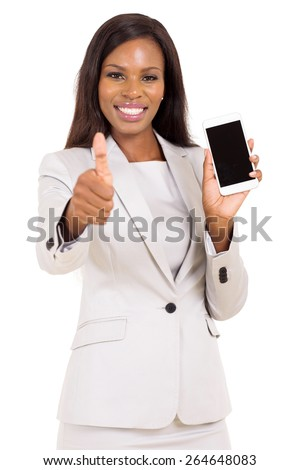 pretty businesswoman holding cell phone and giving thumb up - stock photo