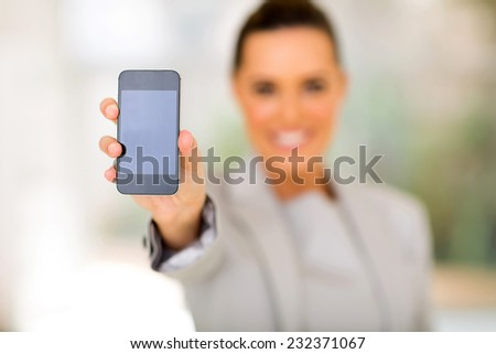 pretty businesswoman holding smart phone - stock photo