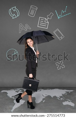 Pretty businesswoman holding umbrella on grey background. Map from NASA http://visibleearth.nasa.gov/view_rec.php?id=2433.  - stock photo