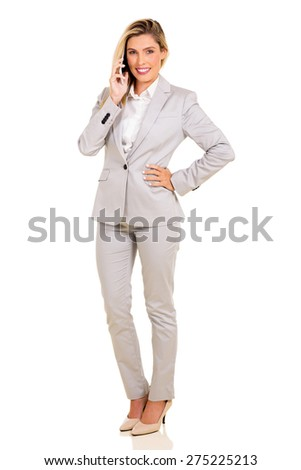 pretty businesswoman talking on mobile phone isolated on white - stock photo