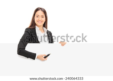 Pretty businesswoman trying to write notes on a blank panel isolated on white background - stock photo