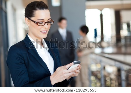 pretty businesswoman using smart phone - stock photo