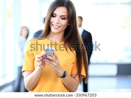 pretty businesswoman using smart phone - stock photo