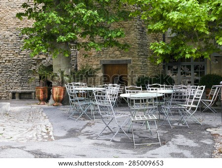 Pretty cafe in French village. Provence. - stock photo