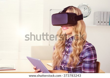 Pretty casual worker using oculus rift against a empty office with a laptop - stock photo