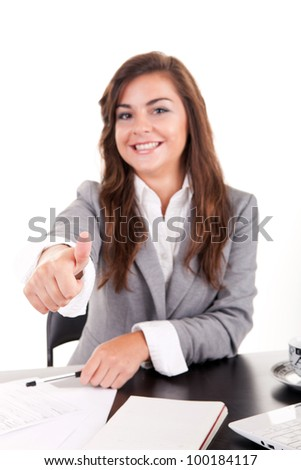 Pretty Caucasian business woman at office desk - stock photo