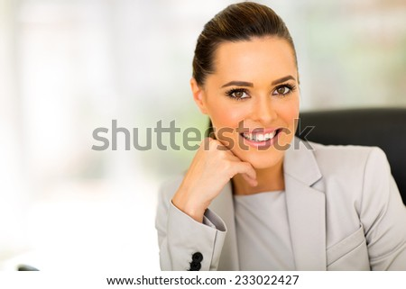 pretty caucasian business woman looking at the camera - stock photo