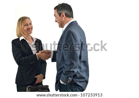 Pretty caucasian business woman shaking hands with a businessman. Isolated on white. - stock photo
