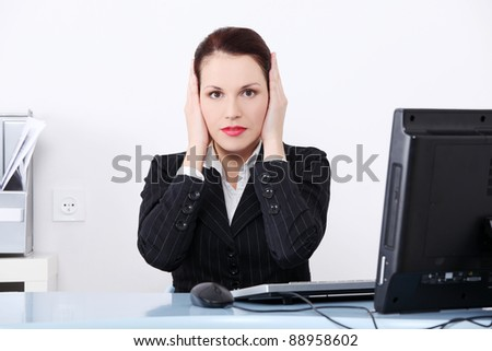 Pretty caucasian businesswoman in the hear no evil pose. - stock photo