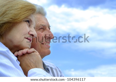 Pretty Caucasian elderly couple in the street - stock photo