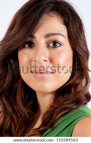 Pretty Caucasian woman in green dress, looking at the camera with a smile, close up - stock photo