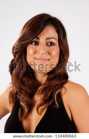 Pretty Caucasian woman with pleasing smile, looking to the right - stock photo
