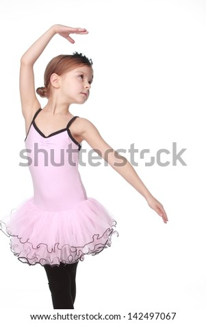 Pretty child express her feelings over dance/Cute little ballet dancer with beautiful hair standing in a ballet pose - stock photo