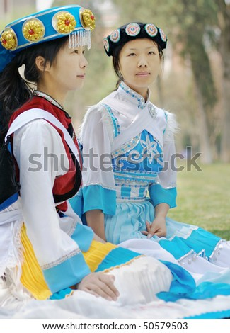 Pretty Chinese girls in the traditional clothes of the Naxi minority culture - stock photo
