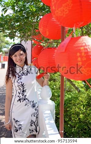 Pretty chinese woman wearing traditional cheongsam celebrate chinese new year - stock photo