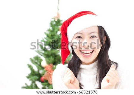 pretty christmas girl in santa hat - stock photo