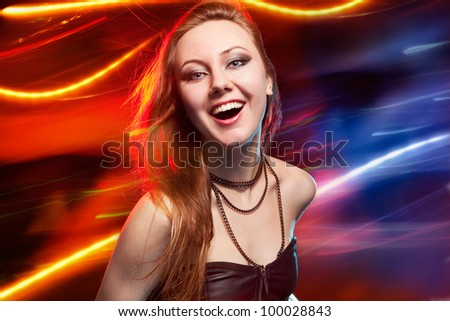 Pretty clubber dancing and looking at camera with smile - stock photo