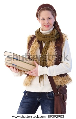 Pretty college student going to school, holding books, smiling at camera.? - stock photo