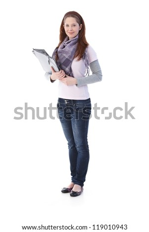 Pretty college student holding folders, smiling. - stock photo