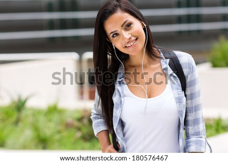 pretty college student listening to music - stock photo