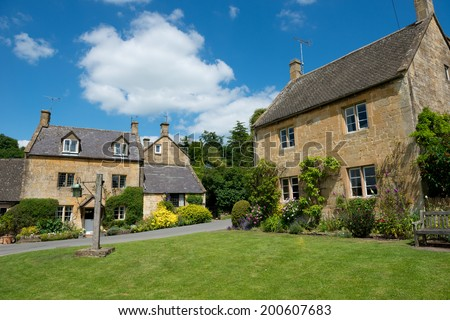 Pretty  Cotswolds cottages, Gloucestershire, England. - stock photo