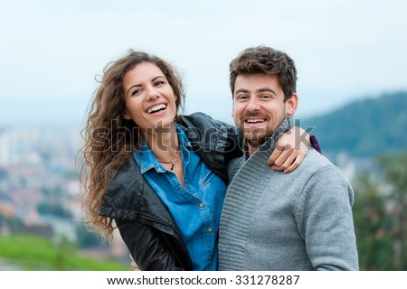 Pretty couple hugging, flirting and laughing. - stock photo
