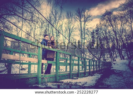 Pretty couple outdoor with nature on background - stock photo